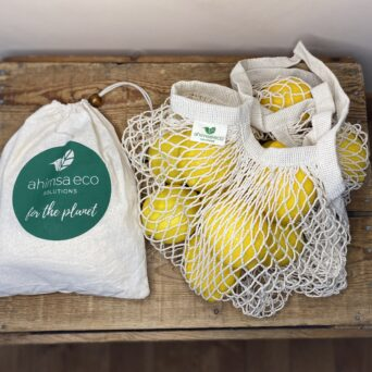 Ahimsa Eco's market bundle includes a crochet market bag and a set of four produce bags. All are made from organic cotton.